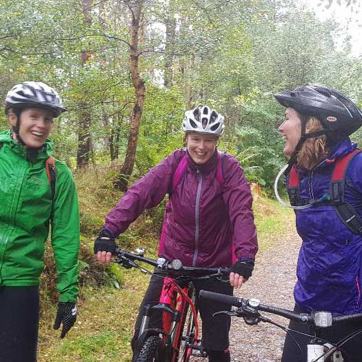 female mountain bikers laughing