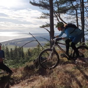 mountain biker rolling a drop